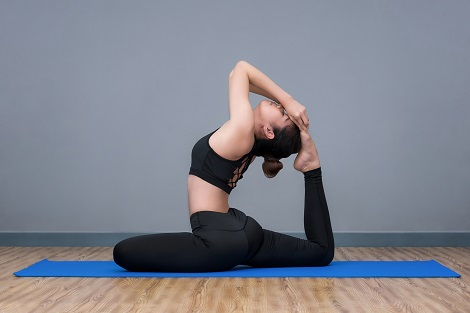 Woman Doing Yoga At Kaya Health Clubs